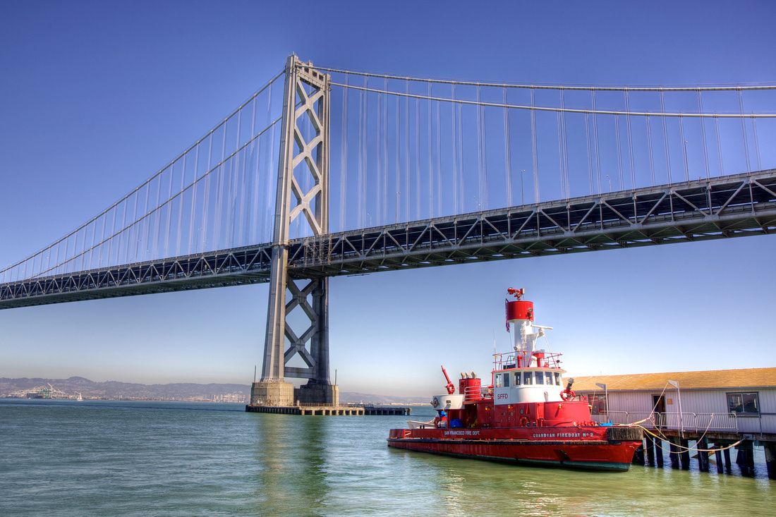 Fireboat under the bay bridge